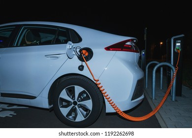 An electric car is charged overnight