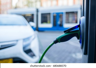 Electric car charger changing power  in Amsterdam ,Netherlands.