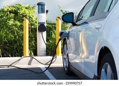 An electric car charging in California