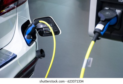 Electric car charging .Close up of power supply plugged