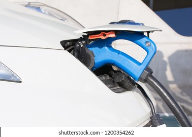 Electric car – charging on charge station. Electromobility environment friendly. Copy space. Refueling electro mobile.