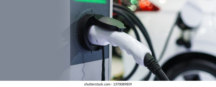 Electric car charging on charge station, Transport which are the future of the automobile