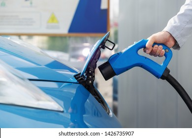 Electric car charging with the power cable supply plugged in