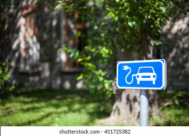 Electric car charging spot traffic sign in blue and white