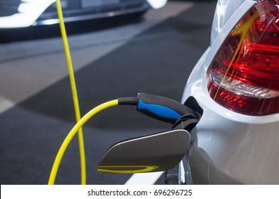 Electric car charging with station, EV fuel advance and modern eco system, Save the earth conception.