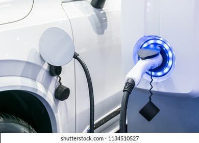 Electric Car in Charging Station new technology new innovation Future energy