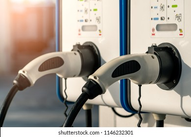 Electric car charging station. Plug for vehicle with electric motor. Coin-operated charging station. Clean energy power. Commercial charging station. Charging point. Infrastructure policy.