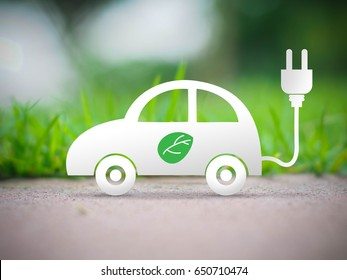 electric car with green leaf icon on blur grass background, ecology and environment concept, photographic mixed with illustration
