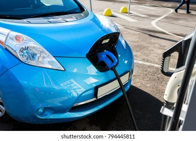 electric car near the charging station in the city