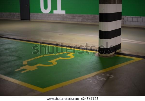Electric car parking place in public garage