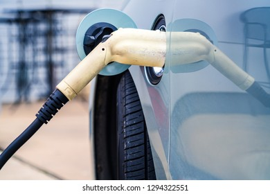 electric car plug in , recharging my electric car at electric car charging station - Renewable and Sustainable Energy