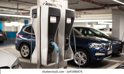 Electric cars in an underground car park at a charging station