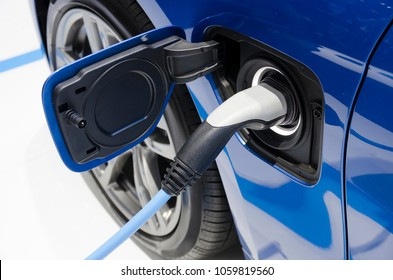Electric charger on EV or electric vehicle. Electric car power recharging