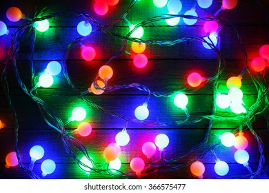 Electric Christmas garland on wooden background