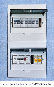 Electric circuit breaker box of home electrical system with new modern electronic electrical meter.