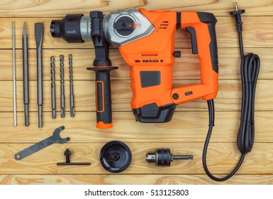 electric drill hammer isolated on wood background.