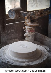 electric drive rotating wheel for jiggering or throwing production process for craft and industrial ceramic in education training with a plaster mould plate and rustic jiggering arm