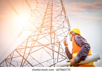 Electric engineer check the high voltage transmission towers.
