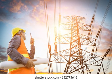 electric engineer inspect the high voltage pole
