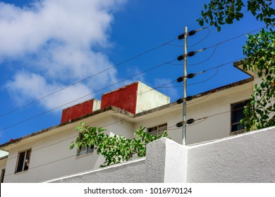 electric fence on the background of the house and trees