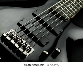 Electric five string bass guitar closeup, for music, entertainment themes
