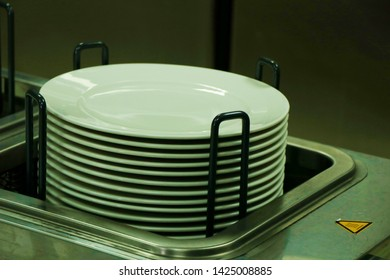 electric food plate warmer with pile of plates