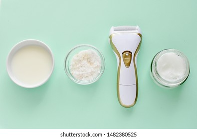 Electric foot file and natural products for feet scrub and softener, milk, salt and coconut oil.