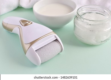 Electric foot file and natural products for feet care milk and coconut oil for softer skin