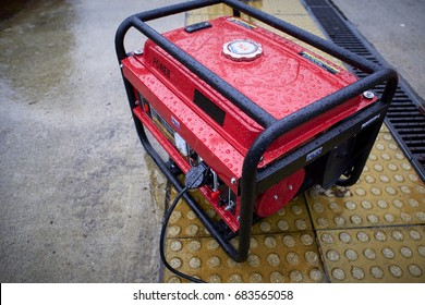 Electric generator, used in the rain on the ground. Fuel motor