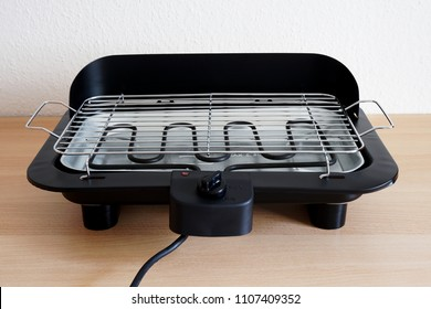 electric grill on kitchen table for indoor barbecue