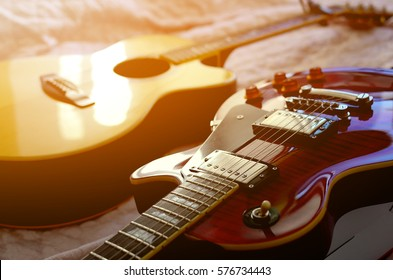 Electric guitar and acoustic guitar, Used to play music and notes.