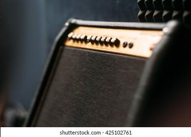 Electric guitar amplifier closep. Selective focus technique on black professional guitar amplifier