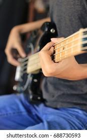 Electric guitar bass play.
