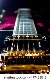 Electric Guitar Closeup of strings and bridge in a case