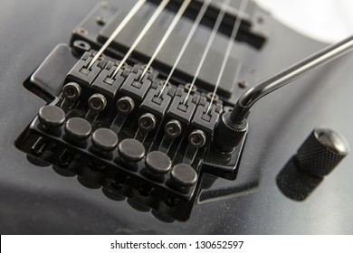Electric guitar detail shots over white backdrop