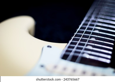 electric guitar, focus on fret. shallow depth of field