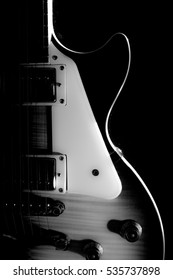 Electric guitar isolated on a black background black and white photo