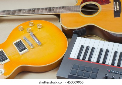 Electric guitar and keyboard  musical close-up