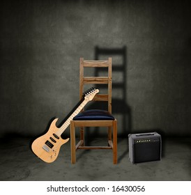 Electric guitar leaning against a chair on a dark grungy stage with an amplifier