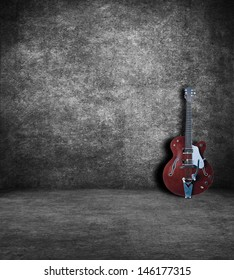 Electric guitar in an old abandoned interior.