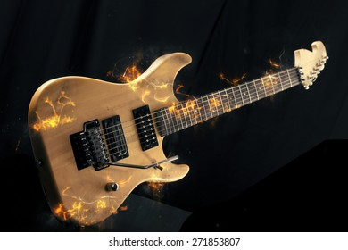 Electric Guitar on fire Isolated on Black Background