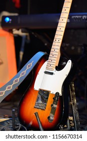 Electric guitar and other musical equipment on stage before conc