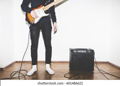 Electric Guitar Playing Teenage Kid with amplifier on White Background. Black and White toned