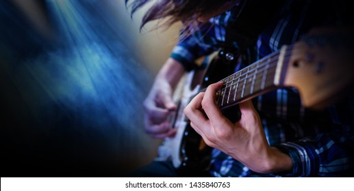 Electric guitar playing. Young men playing electric guitar. Closeup Photography.