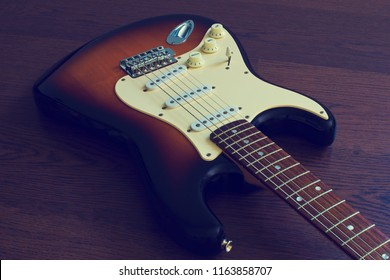Electric guitar stratocaster sunburst closeup, macro abstract