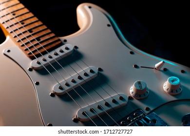 Electric guitar white color closeup detail