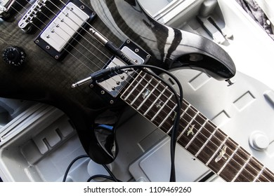electric guitars black color and jack line.
