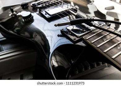 electric guitars black color and jack line
