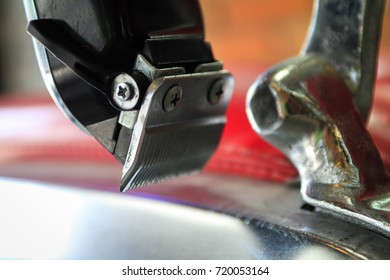 Electric hair clipper hanging on the barber chair at barbershop. Barber shop theme.