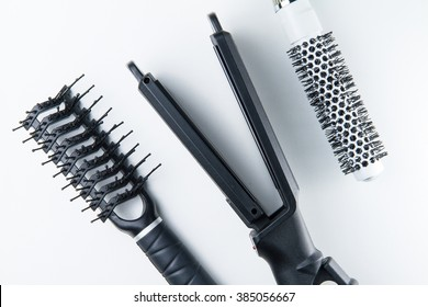 Electric hair straightener brush roll and comb